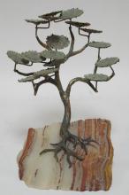 BRONZE TREE MOUNTED ON STONE BY BIJAN BAHAR. 11 3/4 IN H, 7 1/4 IN WIDE