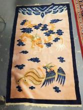 3 FT 1 IN X 5 FT 1 IN CHINESE THROW W/ DRAGON AND PHOENIX BIRD