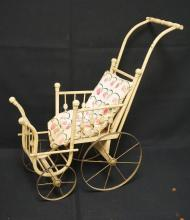 VICTORIAN STICK & BALL STYLE DOLL CARRIAGE, 25 INCH HIGH, 26 INCH FROM HANDLE TO FOOT REST, ALL WOOD W/METAL WHEELS, ORIGINAL STRAW FILLED CUSHION