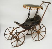 19TH CENTURY JOEL ELLIS STYLE VICTORIAN DOLL CARRIAGE, 25 INCH TALL, 30 INCH FROM FRONT WHEEL TO HANDLE, ORIGINAL LEATHERETTE CANOPY W/POM POM FRINGE, ORIGINAL LEATHERETTE SEAT CUSHION, ORIGINAL PATTERNED PAPER IN CARRIAGE, ORIGINAL PAINTED & STENCILED FINISH, SOME WEAR DUE TO AGE