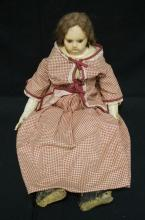 23 INCH WAX OVER COMPOSITION LATE 19TH CENTURY DOLL, CLOTH BODY W/LOWER LEATHER ARMS, OLD UNDERCLOTHES, MOHAIR WIG, SOME WEAR TO FACE