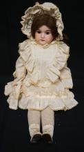 21 INCH ARMAND MARSEILLE 3700 BISQUE HEAD DOLL, LEATHER BODY W/BISQUE LOWER ARMS, LOWER LEG IS BROKEN, NEW WIG AND CLOTHES, MARKED 3700 / A.M 3 ½ III, SLIGHT CHEEK RUB