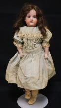 21 INCH ARMAND MARSEILLE 370 BISQUE HEAD DOLL, LEATHER BODY W/LOWER BISQUE ARMS AND LOWER COMPO LEGS (LEGS REVARNISHED), LEATHER TORN AT LOWER LEFT LEG, EYES ARE NEWER REPLACEMENTS, NEW WIG/NEW CLOTHES, MARKED ARMAND MARSEILLE / GERMANY / 370