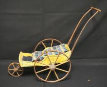 LATE 19TH CENTURY JOEL ELLIS TYPE VICTORIAN STROLLER, ORIGINAL YELLOW PAINT, NEW WOOD PIECE ANCHORING FRONT WHEEL, END PART OF HANDLE IS GONE (WHERE IT IS FASTENED TO BACK OF STROLLER)