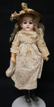 17 INCH P SCHMIDT/ARMAND MARSEILLE BISQUE HEAD DOLL, COMPOSITION STICK TYPE BODY (SOME PAINT CHIPPING), OLD WIG/NEW CLOTHES, MARKED 2 ½ / P. SCHMIDT / GERMANY / A.M.