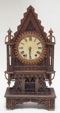 SETH THOMAS MANTEL CLOCK WITH INTRICATELY CARVED FRETWORK. 21 1/2 IN TALL.