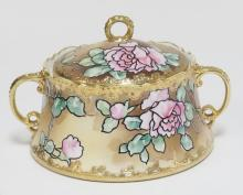 HAND PAINTED NIPPON BISCUIT JAR DECORATED WITH ROSES. 7 IN DIA, 5 1/2 IN TALL.
