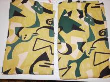 PAIR OF ABSTRACT CURTAIN PANELS. 2 TONE GREEN, BLACK AND WHITE. 8 FT 7 IN H, X 38 IN WIDE