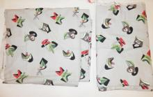 2 BOLTS MID C. ABSTRACT FABRIC. RED, GREEN, BLACK AND WHITE ON A GRAY GROUND.BOTH 6 1/3 YD X 47 IN