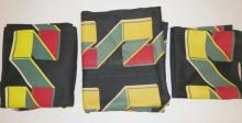 3 PC MID C FABRIC. GEOMETRIC DESIGN ON A BLACK GROUND. 91 IN X 110 IN, 65 IN X 54 IN AND 49 IN X 21 1/2 IN