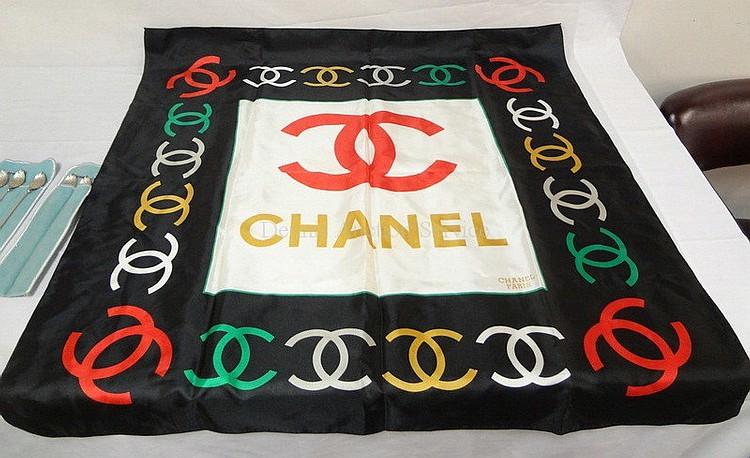 CHANEL, PARIS SILK SCARF; 34 1/2 IN X 33 1/4 IN