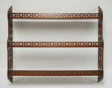 MAHOGANY 3 TIER HANGING SHELF WITH CUTWORK SIDES AND SHELF FRONTS. 34 1/4 INCHES WIDE. 30 INCHES HIGH.