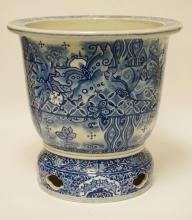 ASIAN BLUE & WHITE PORCELAIN PLANTER DECORATED WITH FLOWERS AND BUTTERFLIES. 15 3/4 INCHES HIGH. 16 1/2 INCHES WIDE.