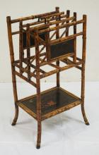 BAMBOO STAND WITH A DIVIDED TOP FOR BOOKS OR MAGAZINES WITH A SHELF BELOW. CHINOISERIE DECORATED PANELS. 14 X 17 AND 32 1/2 INCHES HIGH.