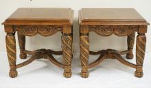 PAIR OF CARVED END TABLES WITH STRETCHER BASES. 26 X 28 AND 25 1/2 INCHES HIGH. ONE CORNER OF A TOP HAS A CHIP.