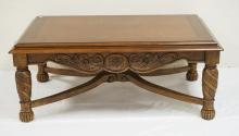 CARVED COFFEE TABLE WITH A STRETCHER BASE. 50 X 32 INCH TOP. 20 INCHES HIGH.