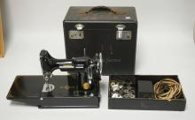 SINGER FEATHERWEIGHT SEWING MACHINE WITH CASE, FOOT PEDAL, AND SOME ATTACHMENTS. SERIAL #AE992037.