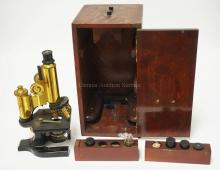 VINTAGE SPENCER MICROSCOPE WITH ADDITIONAL LENSES AND WOODEN CASE.