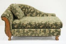 FLORAL UPHOLSTERED CHAISE LOUNGE WITH CARVED LEGS. APPROX 62 INCHES LONG. 37 1/2 INCHES DEEP. 37 INCHES HIGH.