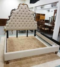 KING SIZE HIGH BACK BED BY *HOOKER* FURNITURE. HEADBOARD WITH TUFTED UPHOLSTERY TRIMMED BY A MIRRORED BORDER.