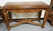 ORNATELY CARVED CONSOLE TABLE WITH A STRETCHER BASE. 20 X 48 INCH TOP. 30 INCHES HIGH.