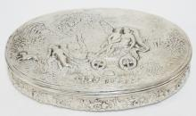 HANAU, GERMANY SILVER OVAL BOX W/ EMBOSSED SCENE ON THE TOP- ANGEL, PUTI, DOG, ETC. 8 IN X 5 IN, 1 1/2 IN H, GOLD WASHED INTERIOR.  12.825 T OZ