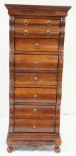 CARVED 7 DRW. HIGH CHEST. DRAWERS ARE VELVET LINED. 22 IN WIDE, 56 3/4 IN H, 16 1/2 IN DEEP AT THE BASE, 10 3/4 IN AT THE TOP