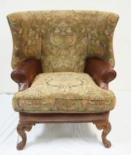 CENTURY BARREL BACK WING ARM CHAIR W/ UPHOLSTERY AND LEATHER. CARVED LEGS.