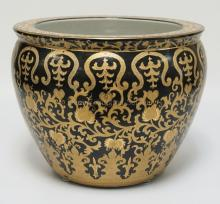 ASIAN PLANTER IN BLACK AND GOLD DECOR ON THE EXTERIOR AND FISH ON THE INTERIOR. 17 INCHES WIDE. 13 1/4 INCHES HIGH.