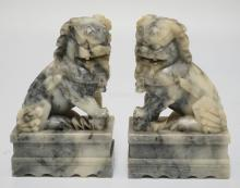 PAIR OF CARVED STONE FOO DOGS. 7 INCHES HIGH.