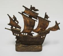 CAST IRON SHIP DOORSTOP. 11 INCHES HIGH.