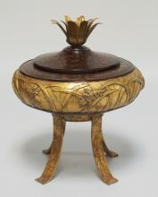 LIDDED JAR ON HIGH LEGS DECORATED WITH GRASSHOPPERS IN RELIEF. GOLD GILT AND MARBLED FINISH. 12 INCHES HIGH.