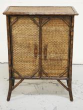 BAMBOO CABINET WITH WOVEN PANELS. 32 INCHES HIGH. 24 INCHES WIDE.