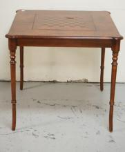 GAME TABLE WITH TURNED LEG AND A REVERSIBLE TOP. 31 INCHES HIGH. 33 1/2 INCHES SQUARE.