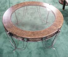 MODERN COFFEE TABLE WITH A METAL BASE AND AN INSET GLASS TOP. 19 1/2 INCHES HIGH. 42 1/2 INCH DIA.