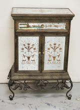 MIRRORED CABINET ON AN IRON BASE. ONE DRAWER AND 2 DOORS. 40 INCHES HIGH. 29 INCHES WIDE.