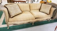 ISENHOUR CARVED AND GILT SOFA MEASURING 88 INCHES LONG.