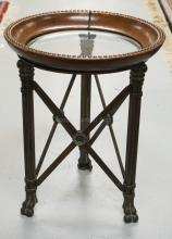 SMALL ROUND TABLE WITH PAW FEET, AND A DISH TOP HAVING BRASS STUDDED FAUX LEATHER. 25 INCHES HIGH. 20 INCH DIA.