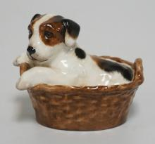 ROYAL DOULTON *TERRIER PUPPY IN BASKET* HN2587* PORCELAIN FIGURE MEASURING 2 7/8 INCHES HIGH.