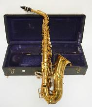 ELKHART BUECHER ALTO SAXOPHONE WITH CASE. SERIAL #149694. HAS FINISH WEAR AND A COUPLE VERY SMALL DINGS TOWARD THE BOTTOM.