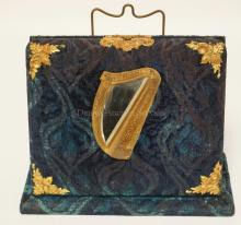 VICTORIAN STANDING VELVET PHOTO ALBUM WITH BRASS MOUNTS INCLUDING A HARP FRAMED MIRROR. HAS WEAR TO SOME OF THE VELVET.