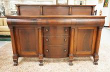 MAHOGANY EMPIRE SIDEBOARD WITH FULL COLUMN FRONT, CLAW FEET, COLUMNED SPLASH, 6 DRAWERS, 2 DOORS. SOME FINISH WEAR ON THE TOP. 72 INCHES WIDE, 49 1/2 INCHES HIGH