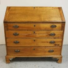 ANTIQUE SLANT FRONT DESK WITH A DOVETAILED CASE, BRACKET FEET, AND A COMPARTMENTED INTERIOR WITH FIGURED DRAWER FRONTS. 40 INCHES WIDE. 39 1/2 INCHES HIGH.