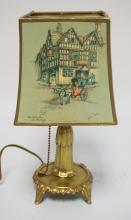 BUDOIR LAMP WITH SHADE HAVING SCENES BY CLYDE COLE. 11 1/2 INCHES HIGH.