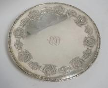 STERLING SILVER FOOTED TAZZA WITH RELIEF DECORATIONS INCLUDING FLORAL SWAG AND FLORAL URNS. 10 1/2 INCH DIA. 16.1 TROY OZ. MONOGRAMMED.