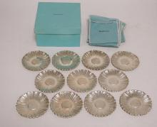LOT OF 11 TIFFANY & CO MAKERS STERLING SILVER COASTERS/BUTTER PATS. 3 3/4 INCH DIA. COMES WITH FELTS FOR EACH AND BOX. 21.26 TROY OZ.