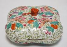 ASIAN PORCELAIN COVERED BOX. ENAMEL DECORATED WITH MOTHS, FLOWERS, AND FOLIATE. CHOP MARK ON BOTTOM. 6 1/4 INCHES WIDE.