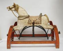VINTAGE CARVED WOODEN CHILDS ROCKING HORSE TOY. 33 1/2 INCHES LONG. 28 3/4 INCHES HIGH. HAS WEAR CONSISTANT WITH AGE.