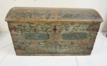 ANTIQUE DOME TOP IMMAGANTS CHEST. DOVETAILED CONSTRUCTION. PAINT DECORATED WITH BIRDS, FLOWERS, AND FOLIATE ON THE FRONT AND INSIDE OF THE LID. DATED 1773. HAS WEAR. 46 1/2 INCHES WIDE. 25 INCHES HIGH.