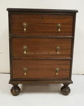 3 DRAWER CHEST WITH BUN FEET. 29 1/4 INCHES HIGH. 22 INCHES WIDE.